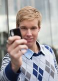 Young man with cameraphone Royalty Free Stock Photos