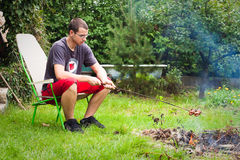 Young man camping Royalty Free Stock Photos