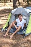 Young man camping stock photo