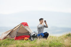 Young Man On Camping Trip In Countryside Royalty Free Stock Images