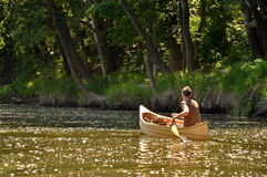 Young man in a canoe Stock Image