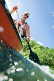 Young Man Canoeing Stock Photos