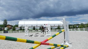 Young man canter on the horse at the arena stock video footage