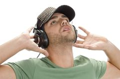 Young man with cap and headphone Stock Image
