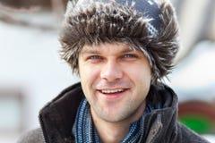 Young man with cap outdoor Stock Photos