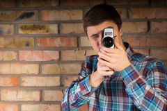 Young Man Capturing Something Using Camera Stock Image