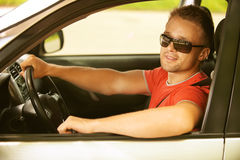 Young man in car Stock Images