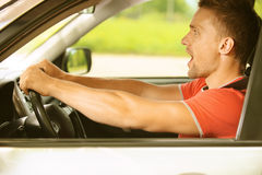 Young man in car Stock Image