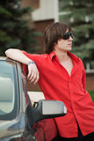 Young man with a car Royalty Free Stock Photography