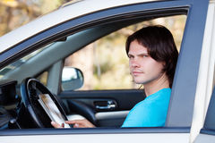 Young man in car Royalty Free Stock Images