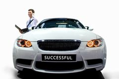 Young man by car. Young businessman by modern white car on white isolated Stock Photos