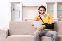 Young man after car accident suffering at home royalty free stock photography