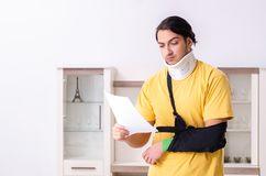 The young man after car accident suffering at home. Young man after car accident suffering at home royalty free stock photos