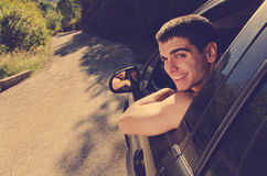 Young man in car Stock Photography