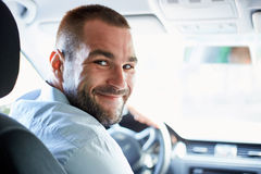 Young man in car Royalty Free Stock Image