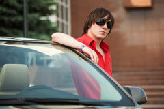 Young man at the car Stock Images