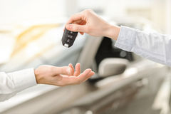 Young Man in a Car Rental Service Test Drive Concept. Young men standing near the car getting keys rental service stock images