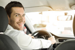 Young Man in a Car Rental Service Test Drive Concept Stock Photos