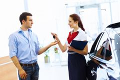 Young man at car salon Royalty Free Stock Photo