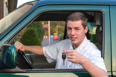 Young man in a car Stock Images