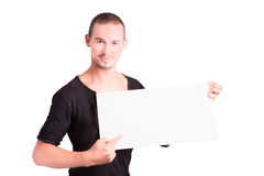 Young man with cardboard Royalty Free Stock Image
