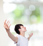 Young man carefree outstretched arms Stock Images