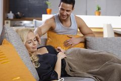 Young man caressing sleeping girlfriend Royalty Free Stock Images