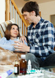 Young man caring for sick girl Royalty Free Stock Photo
