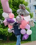 A young man carries balloons to a children`s party. A young man carries balloons to a children`s party stock photo