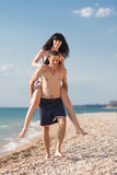 Young man carries girl Stock Photo