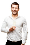 Young man carries glass of champaign Royalty Free Stock Images