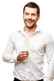 Young man carries glass of champaign Stock Photo