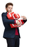Young man carries a great amount of presents Stock Photos