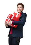 Young man carries a lot of presents Royalty Free Stock Photography