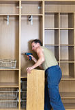 The young man carries out housework Royalty Free Stock Images