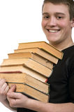 A young man carries a stack of books. Laughing young man carries a stack of books Royalty Free Stock Photo