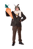 Young man with carrot Royalty Free Stock Photo