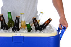 Young Man Carrying Beer Cooler Royalty Free Stock Photography