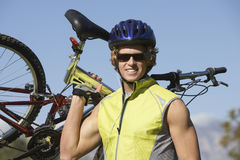 Young Man Carrying Bicycle Stock Photos