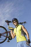 Young Man Carrying Bicycle Royalty Free Stock Photo