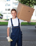 Young man carrying a box Royalty Free Stock Photos