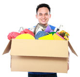 Young man carrying box full of stuff Royalty Free Stock Images