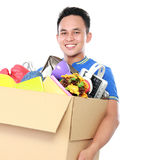 Young man carrying box full of stuff Royalty Free Stock Image