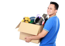 Young man carrying box full of stuff Stock Image