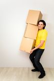 Young man carrying boxes Stock Photo