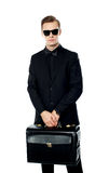 Young man carrying briefcase Royalty Free Stock Image