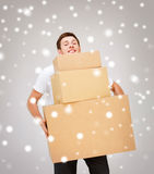 Young man carrying carton boxes Royalty Free Stock Images