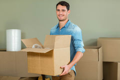Young man carrying carton boxes Stock Photo