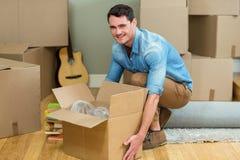 Young man carrying carton boxes Stock Photo