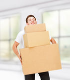 Young man carrying carton boxes Stock Photography